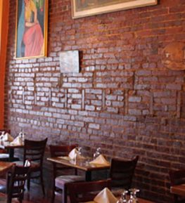 Jyoti Indian Cuisine Inside View of the red brick wall